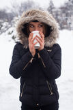 Winter, woman and hot beverage Royalty Free Stock Image