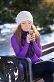 Winter woman with hot coffee Stock Image