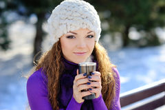 Winter woman with hot coffee Stock Images