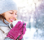 Winter woman with hot drink outdoors Stock Image