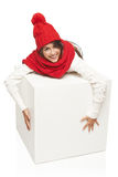 Winter woman hugging big white box Royalty Free Stock Photography