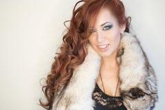 Winter Woman in Luxury Fur Coat. Beautiful Girl in Fur Hood. Winter Woman Portrait Stock Photos