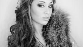 Winter Woman in Luxury Fur Coat. Beautiful Girl in Fur Hood. Winter Woman Portrait Stock Image