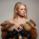Winter Woman in Luxury Fur Coat. Beauty Fashion Model Girl. beautiful stylish blond girl Stock Image