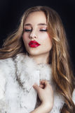 Winter Woman in Luxury Fur Coat. Beauty Fashion Model Girl in Bl. Ue Fox Fur Coat. Perfect Makeup and accessories. Beautiful Luxury Winter Lady Royalty Free Stock Photos
