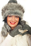 Winter woman making heart shape Royalty Free Stock Photos