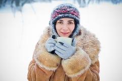 Winter woman with a mug Stock Image
