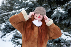 Winter woman outdoor portrait with cap covering eyes Royalty Free Stock Images