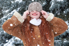 Winter woman outdoor portrait with snow on head Stock Photography