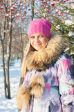 Winter woman in park Stock Image