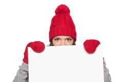 Winter woman peeking out of whiteboard Royalty Free Stock Photos