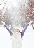Winter woman play with snow Royalty Free Stock Image