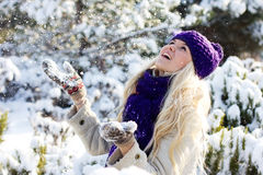 Winter woman playing with snow Royalty Free Stock Image