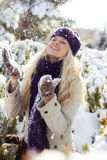Winter woman playing with snow Royalty Free Stock Photography