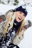 Winter woman playing with snow Royalty Free Stock Photos