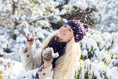 Winter woman playing with snow Stock Photography