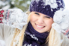 Winter woman playing with snow Royalty Free Stock Images