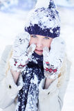 Winter woman playing with snow Royalty Free Stock Photo