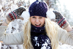 Winter woman playing with snow Stock Image