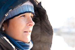 Winter woman portrait. Portrait of a winter woman at seaside royalty free stock images