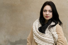 Winter woman portrait. Young woman model wearing winter coat and scarf Stock Images