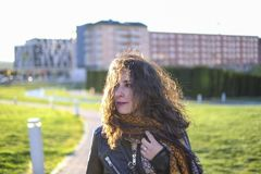 Winter woman portraits walking  in park stock photography