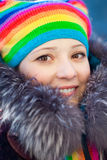 Winter woman in rainbow hat Royalty Free Stock Images
