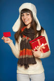 Winter woman with red gift box and credit card Royalty Free Stock Images