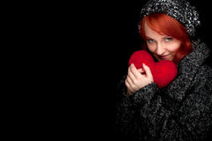 Winter woman with red heart Royalty Free Stock Photo