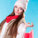Winter woman with red paper shopping bag Stock Photo