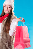 Winter woman with red paper shopping bag Stock Images