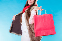 Winter woman with red paper shopping bag Royalty Free Stock Photography