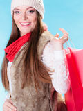 Winter woman with red paper shopping bag Stock Image
