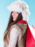 Winter woman with red paper shopping bag Royalty Free Stock Photos