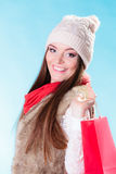 Winter woman with red paper shopping bags Royalty Free Stock Photo