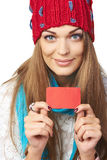 Winter woman showing blank credit card Royalty Free Stock Photo
