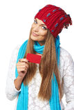Winter woman showing blank credit card Royalty Free Stock Images