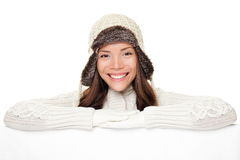 Winter woman showing sign banner royalty free stock photos