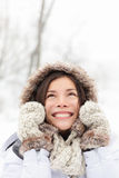 Winter woman in snow. Looking up at copy space outside on snowing cold winter day. Portrait multiethnic Caucasian Asian female model outside in first snow Royalty Free Stock Photography