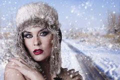 Winter woman on snow Stock Photo