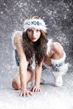 Winter woman on snow and grey background Stock Image