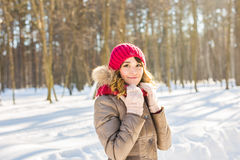Winter woman in snow looking at camera outside on snowing cold day. stock photos