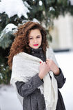 Winter woman in snow looking up Stock Image