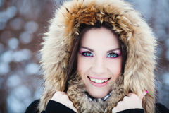Winter woman in snow outside on snowing cold winter day. Royalty Free Stock Images