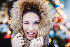 Winter woman in snow outside on snowing cold winter day. Stock Image