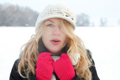 Winter woman in snow photo, looking and blows breath Royalty Free Stock Photos