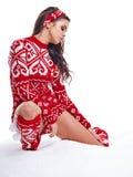 Winter woman on snow in studio Stock Image