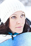 Winter woman with snowboard Stock Photos