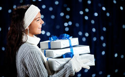 Winter: Woman with Stack of Gifts Laughing Royalty Free Stock Image