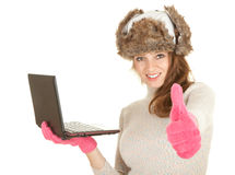 Winter woman using laptop Royalty Free Stock Photography